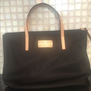A black Kate spade tote purse
